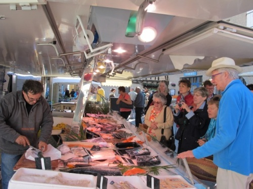Buying fresh fish at Lautrec market